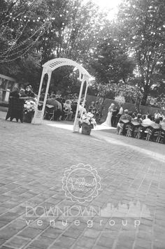 outdoor wedding chandelier arbor brick patio