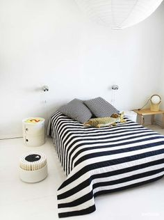 stripy bedsheet. That's an awesome way to make a simple space really pop.