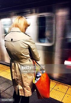 Foto stock : Rear View Of Woman Standing On Railroad Station Platform