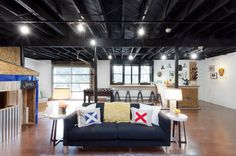 Paint the basement ceiling black instead of putting up a drop in ceiling industrial basement by Brunelleschi Construction Exposed Basement Ceiling, Basement Ceiling Painted, Basement Ceiling Options, Industrial Basement, Open Ceiling, Basement Ideas, Ceiling Ideas, Basement Decorating, Basement Ceilings