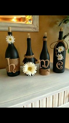 Super cute DIY idea. Wine bottles, spray paint, twine and letters!