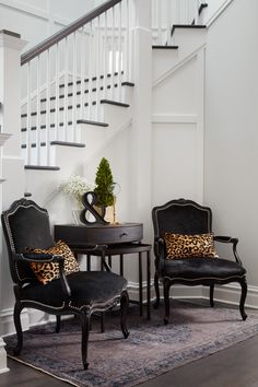 Traditional Staircase: Eclectic furnishing in front of black and white staircase..