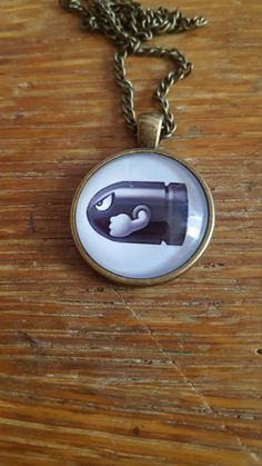 Bullet Bill Necklace by AwesomeOddities on Etsy