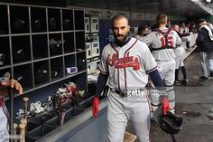 Nick Markakis of the Atlanta Braves in the dugout preparing to bat during the Atlanta Braves Vs New York Mets MLB regular season game at Citi Field on May 02, 2016 in New York City.