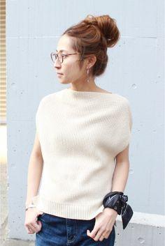 I like the unusual cut of the sweater.