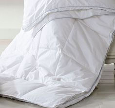 Ultra Loft Microfibre HILTON DELUXE  This beautifully constructed quilt, uses a 300 thread pure cotton cover to guarantee a naturally healthy and restful night's sleep. Premium microfibre fill emulates the light, fluffy air trapping properties of duck and goose down.  Features: Mircofibre fill 300 thread count Japara cotton cover High performance down like fibre Air well before use Gentle machine wash in warm water, or cold water with mild detergent Lie flat in warm ventilated area, turning…