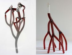 "Artist Etienne Meneau creates radical interpretations of a traditional wine decanter by utilizing the abstracted forms of blood veins, hearts, and root systems. Each container from his ""Strange Carafes"" series is hand-blown from borosilicate, and while many of the objects are technical"