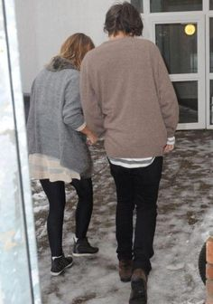 Twitter / the1Dscene: Harry is helping this girl ... Probably to walk over the ice... Or she fangirled to hard...