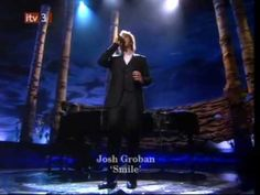 Josh Groban-Smile :D I TOTALLY LOVE HIS VOICE!!! Smile though your heart is aching Smile even though it´s breaking When there are clouds in the sky You´llget by If you smile though your fear and sorrow Smile and maybe tomorrow You´ll see the sun come shining through for YOU<3