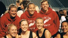 Emily Bennett Taylor (front row, second from left), at a 2001 Idaho State High School track meet during her junior year. Her track coach Angela Stark (back row, center), would become her surrogate 14 years later, after Taylor beat lung cancer.