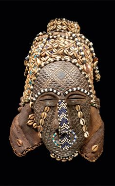 Africa | Mask from the Bushoong Kuba people of DR Congo | Wood, raffia textile, cowrie shells and glass beads