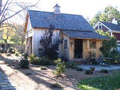 such a cute cedar barn and garden shed