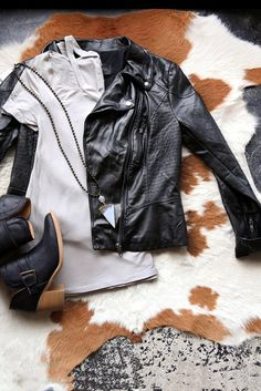 Our Gunmetal faux leather jacket pairs perfectly with any basic, is a medium weight and has extra zippers and pockets to add texture. GENERAL INFO: - Self: 100% Polyurethane, Lining: 100% Cotton - Han