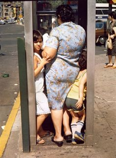 Phonebooth by Helen Levitt i had to get a close up to make sure this wasn't me my sister and my grandma and tbh i'm still not sure.