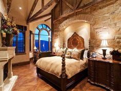 Master Bedroom- I like the use of plaster walls to add contrast to the stone walls a very nice look.: