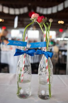 I don't normally post wedding things, but seriously, Coke bottles as centerpieces? If thats not me, I don't know what is. LOVE IT.