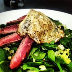 Eddie's Farmer's Market Salad, one of our fresh daily specials. New York strip steak, egg, spinach, and a sautéed to order bacon vinaigrette.