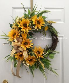 Heres a beautiful Sunflower wreath to brighten up your entry way this summer. Seven large and happy sunflower faces are surrounded by lush foliage and yellow filler flowers. Nestled in the center is a large bow made up of burlap ribbon and yellow gingham ribbon. Wouldnt this be pretty on your door?  Measuring from highest stem tip to the very lowest, it measures about 25 inches around. The depth is about 7 inches. Its base is an 18 inch grapevine wreath. Wreaths make great gifts! Mothers…