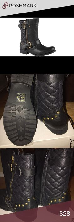 ALDO SALVAZA BLACK BOOT Material: Synthetic. Sole: Rubber. Complete your most charming outfits with these rugged and stylish motorcycle boot. Biker boot. Quilted upper. Side buckles and zippers on both sides of the boots. Brass tone details on back of boot by ankle. Gently used. On box it says US 8 EU9 Aldo Shoes Ankle Boots & Booties