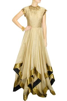 DECCAN DREAMS - Gold flower embellished triangle hem gown by Pranthi Reddy #new #designer #fashion #couture #shopnow #perniaspopupshop #happyshopping