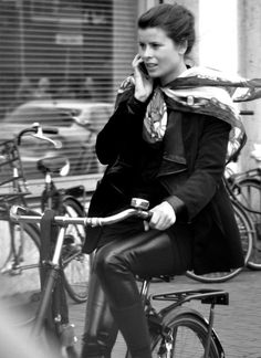 Dutch cycling. Is it illegal to bike and phone in the car? Not so on the bike!