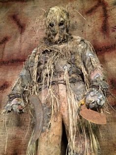 A scarecrow by definition is a decoy or mannequin in the shape of a human which is dressed in old clothes and placed in fields to discourage birds such as crows or sparrows from disturbing and feeding on recently cast seed and growing crops.