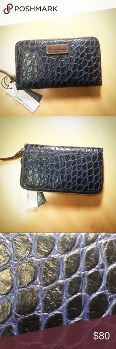 Dooney & Bourke navy embossed leather wallet Dooney & Bourke leather wallet.  The navy leather is soft with an embossed crock pattern and classic D&B brown leather trim.  Timeless and classic, this is a great wallet!  This New with tags and care card. Doo