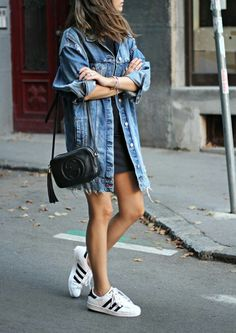 Oversized denim jacket, with mini dress and sneakers
