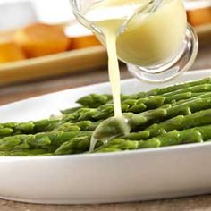 Let the flavor of the fresh vegetable shine through when you combine chicken broth and butter to make a light and flavorful glaze to coat tender-crisp asparagus.  This recipe goes from fridge to table in just 15 minutes.