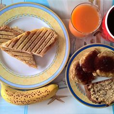 Thursday breakfast spread: A smoked pork, cheddar and mozzarella grilled sandwich with a smoked cheese crust, a couple of small pancakes with strawberry jam, a slice of chocolate chip banana bread and a banana. #thenewbreakfasteverydayproject #livingmylifemyway