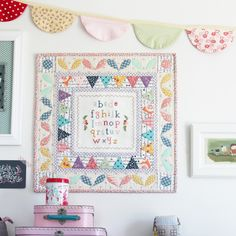 ABC Modern Medallion Wall Quilt with cross stitch sampler by Amy of nanacompany