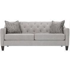 Take classic inspiration, put them on a chic frame and the result is the fabulous Densmore sofa. This sofa blends modern and traditional elements beautifully with features like sleek track arms, tapered legs and button tufting, and the graphic-print pillows are sure to make a statement as well. The light gray upholstery will look great with any design scheme.