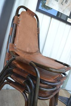 amazing steel and cognac leather industrial stacking chairs. i want!