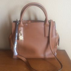 Michael Kors NEW Michael Kors brand new brown handbag still has tissue wrap on it. Comes with 1 dust cover. Michael Kors Bags Shoulder Bags
