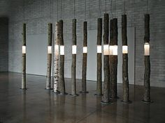 Mystic Woodland Installations Ione Thorkelsson – Manitoba artist Ione Thorkelsson's 'Arboreal Fragments' consists of a cluster of tree trunks fitted with frosty glass inserts. Lamp Design, Lighting Design, Artistic Installation, Wood Lamps, Light Art, Wood Art, Sculpture Art, Abstract Sculpture, Floor Lamp