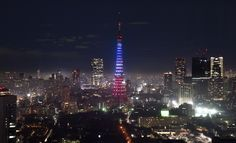 In response to the terrorist attacks in Paris, the Tokyo Tower is lit up for victims memorial in the same three colors as the French national flag on November 15, 2015. Seven Islamic State jihadists carried out the worst attacks ever on French soil, sowing terror at six locations in Paris in a rampage on November 13 that left at least 129 people dead. AFP PHOTO / KAZUHIRO NOGI (Photo credit should read KAZUHIRO NOGI/AFP/Getty Images)