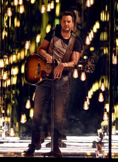 Luke Bryan Photos Photos - Co-host Luke Bryan performs onstage during the 52nd Academy Of Country Music Awards at T-Mobile Arena on April 2, 2017 in Las Vegas, Nevada. - 52nd Academy of Country Music Awards - Show