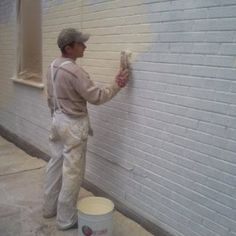 Some advice on how to successfully paint a brick wall