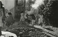 Civilians Flee a National Guard Attack, San Lorenzo — Arturo Robles.  El Salvador : Work of Thirty Photographers (1983). CSUSM.