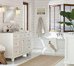 Coastal living Clean styled bathroom. Porcelain Cast-Iron Freestanding Pedestal Bathtub & Chrome finish Fittings