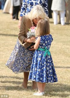 The Duchess was delighted with the bouquet of flowers she received from five year old Hollie Ford today at the Sandringham Flower Show.  July 30, 2014