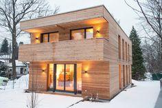 Holzhaus in Erlenstegen: moderne Häuser von Jenohr + Mezger