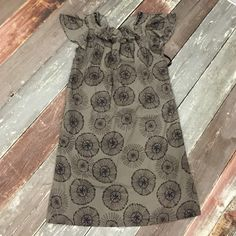 """Dress Dress from target. EUC. Used once. 100% polyester. Color is taupe. """"Circles"""" dark brown with navy accents. Ruffle detail at neck. Ribbon tie at back of neck. Mossimo Supply Co Dresses"""