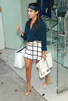 """Keeping Up with the Kardashians"" stars Khloe and Kourtney Kardashian drop in at their DASH store on September 19, 2013 in West Hollywood, C..."