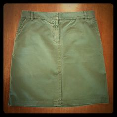 Green cotton chino skirt Color best represented in cover shot. Zipper fly and belt loops. Side seam pockets at either hip,  and two back flap pockets. J. Crew Skirts