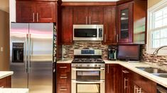 Our contemporary kitchen storage cabinets are functional and eye-pleasing. Get the best value for the money you spend by selecting the best solid wood kitchen cabinets from us. All wood cabinetry is the perfect balance between quality and price. #kitchen #cabinets #kitchencabinets #kitchenmakeover #kitchenremodel #newlook #WoodenCabinet #affordableprice #homedecore #highquality #bestvalue Ugly Kitchen, Solid Wood Kitchen Cabinets, Kitchen Cabinets For Sale, Solid Wood Kitchens, Brown Cabinets, Kitchen Cabinet Storage, Wooden Cabinets, Custom Cabinets, Storage Cabinets