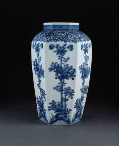 Jar with flowering plantsside