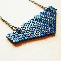 Beaded triangle pendant- shows how to leave holes in peyote bead fabric.