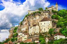 Overlooking the Alzou canyon, the medieval village of Rocamadour, France built into the cliffside on successive levels, Lake Annecy, Valley Village, Destinations, Beaux Villages, French Countryside, Medieval Town, Pyrenees, Beautiful Buildings, Beautiful Places