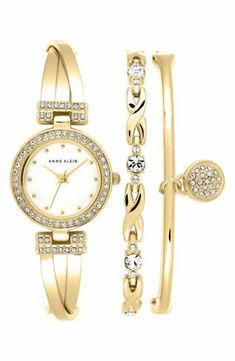 Anne Klein Watch & Bangles Set. An elegant crystal-studded bangle watch with a chic crossover design is paired with a set of coordinating bracelets for a cool, ready-to-go stacked wrist. #ValentinesDay